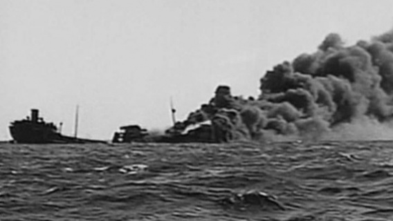 An allied merchant ship is sunk by a German U-boat