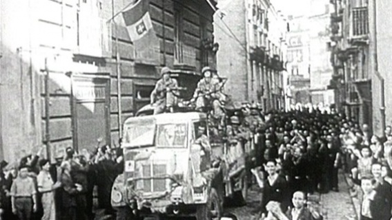 American troops enter an Italian town shortly after landing at Salerno